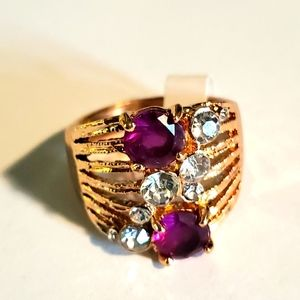 Gold style fashion ring with pink and white insets.